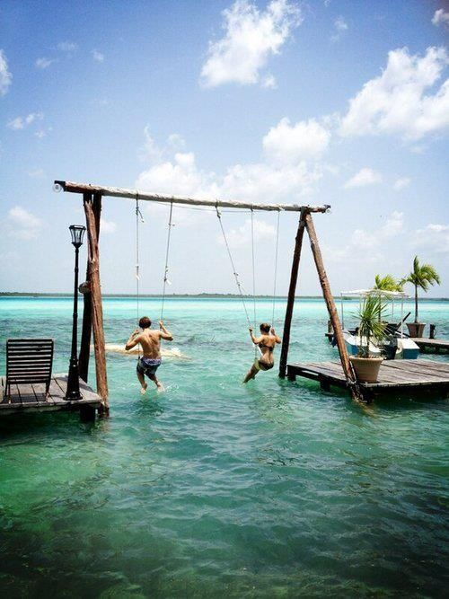 Puerto Costa Maya, Mexico. Swing over the Lake of Seven Colors on a double sea swing. Because of the multiple shades of blue, the