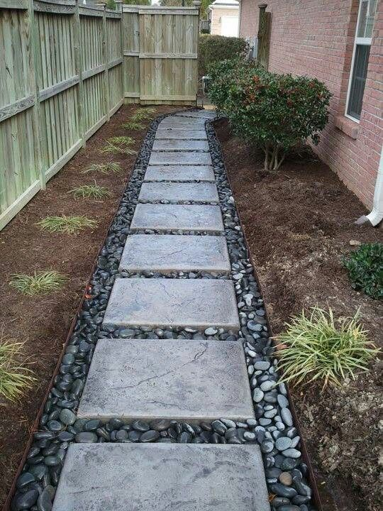 good solution for problem area: river rock and pavers