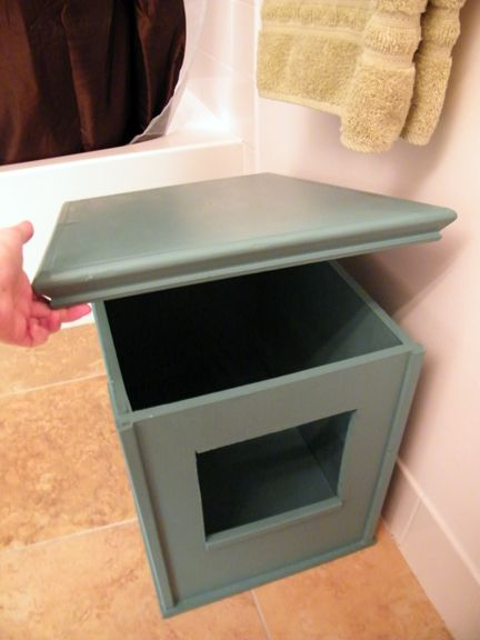 Make your own cat litter box cover. We have to do this for Mischief in our new house!