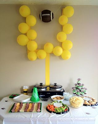 Football party idea!  The yellow posterboard and yellow balloons cost under $2.00.  I would suggest tacks for hanging it up.  Find