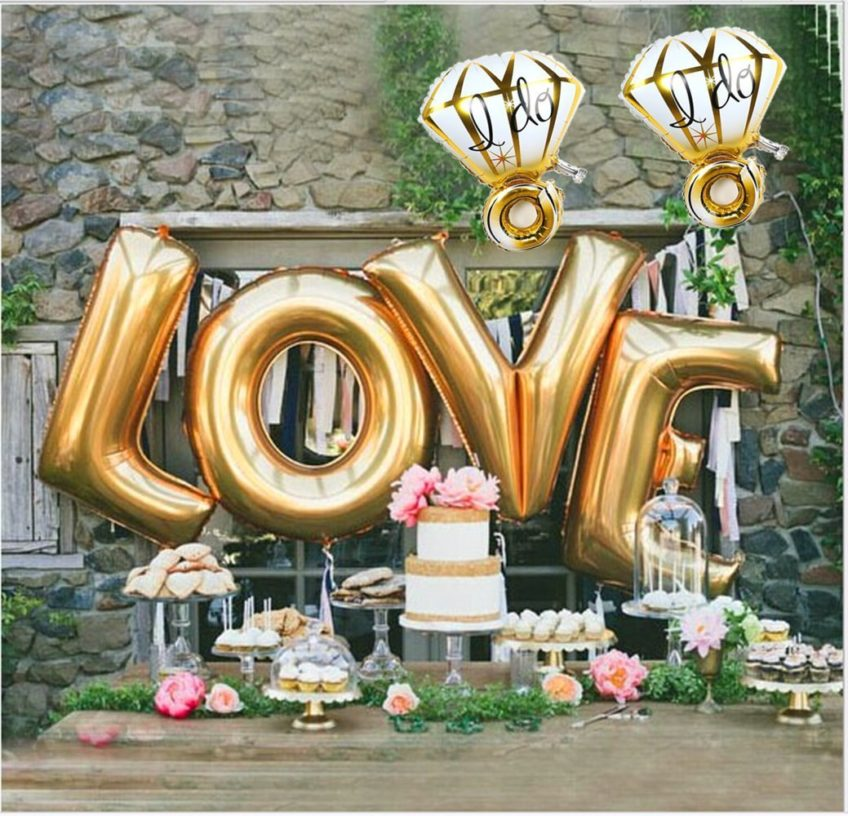 Engagement party decor idea – gold LOVE balloons and diamond balloons with dessert display {Courtesy of Sharing Party Ideas}