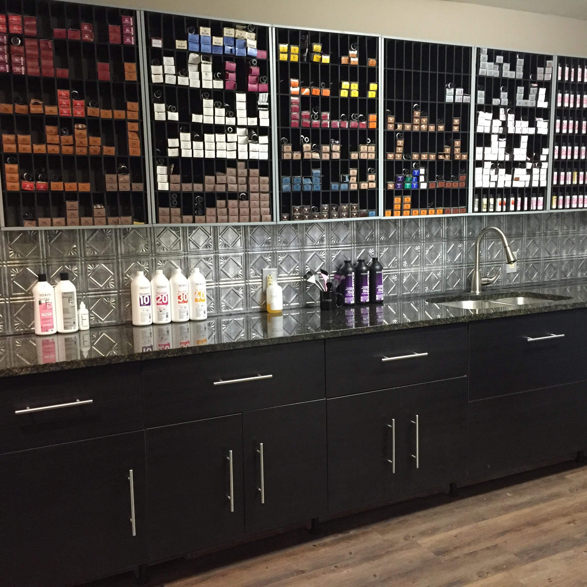 Each stylist would have their own section. :) Developer bottles under cabinet. Under cabinet lighting.