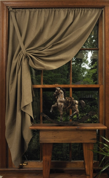 Simple tie back curtain….love it pulled toward the top on one side…..drapes well! Sooo plain and prim!