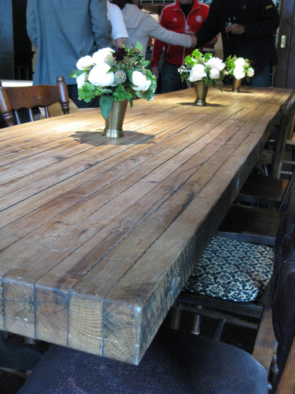 putting the planks on their ends for a DIY table top – would make a great rustic table for the back porch