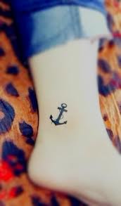 i want an anchor tattoo with words placed around it saying something to the effect of keeping my faith in place .. but I haven't