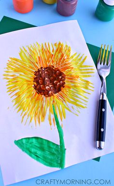 Simple Fork Print Sunflower Craft #Spring art project for kids   CraftyMorning.com