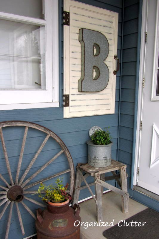 I have two shutters that this might work! Outdoor Junk Vignette & Cabinet Door Decor Project Tutorial