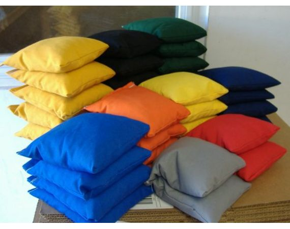 How to make cornhole bags.  Have a good 'ole fashioned party with sack races, egg on spoon races, water balloon tossing,