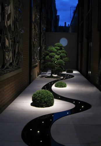 Cool curved path with lights.  Wow! [ TheGardenFountainStore.com ]