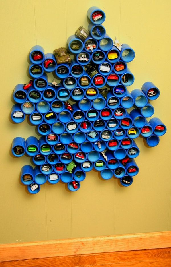 Another super creative ways to store all those Hot Wheels cars or craft supplies, use PVC pipe! Make an artsy design on the wall