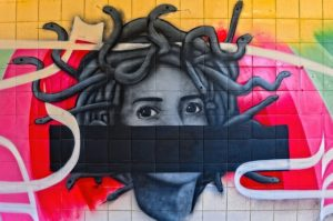 Photo image of a graffiti style painted mural of Medusa.