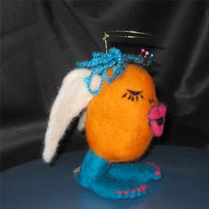 """Angel Lips"" Tape Measure hidden behind lips. Needle felted"