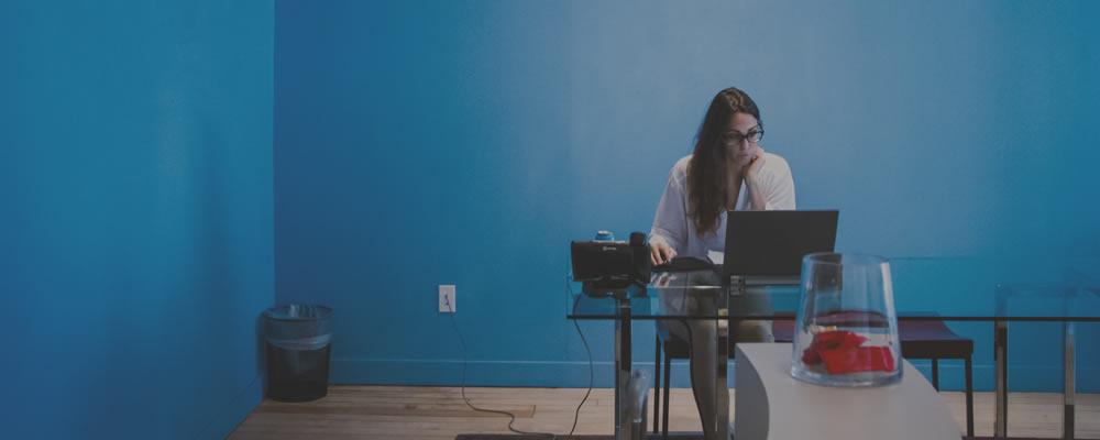 freelance designer sitting at desk