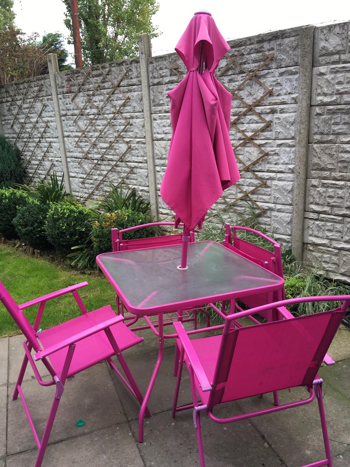 pink patio glass table 4 chairs umbrella