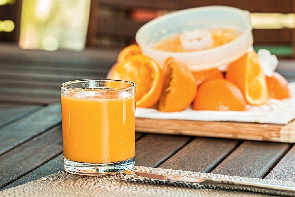 orange juice is squeezed