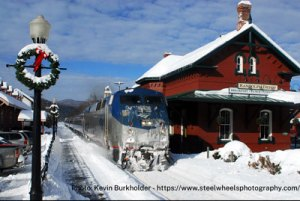 Beautiful Christmastime snow photo of Amtrak's Vermonter at Randolph station by Kevin Burkholder