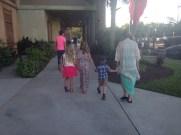 Cousins holding hands
