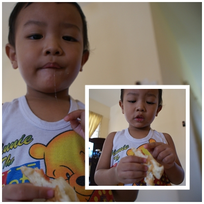 showing me that he disliked the jam for his bread. at the same time, trying hard to ctrl the saliva. ish!