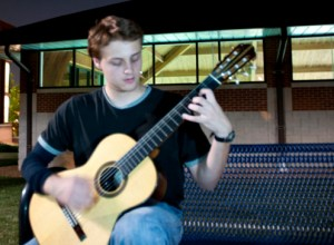 Freshman Eliot Wilde plays his concert guitar outside the University Center. Wilde plays mostly classical music. MEGAN FAVIGNANO/ The Journal