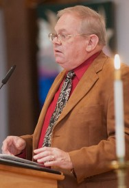 Robert Moody, resolution committee clerk and member of First Congregational Church of Webster Groves, tells the church the committee's process of writing the final resolution. PHOTO BY MACKENZIE WILDER