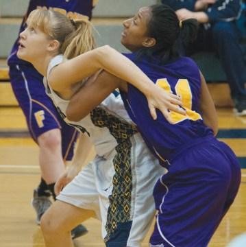 Stephanie Hughes (in white), a freshman guard, looks for the rebound on Dec. 7 against its Big Bend rival, Fontbonne University (Mo.). The women's basketball team beat Fontbonne 64-52. PHOTO BY MACKENZIE WILDER