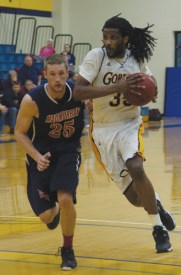 Aaron Griffin, a junior center, helped the Gorloks gain a win against MacMurry on Feb. 8, 2014.  The Gorloks have three more games until the conference tournament. MACKENZIE WILDER - The Journal