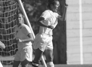 Photo Contributed by Webster Athletics Angela Martinez Brooks knocks a ball off of her head on the soccer field. She was inducted into the Webster Athletics Hall of Fame on Feb. 8 for her contributions to the team. Brooks graduated in 2003.