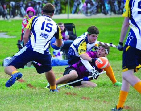 Photo Contributed by Nick Apple Jake Boshears makes a tackle. Dane Davis (15) said that quidditch is most similar as a sport to rugby.