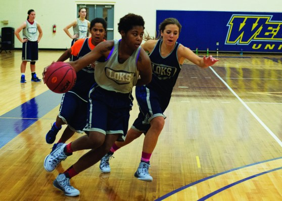 Kristen Pruser / The Journal Junior DeRita Silas drives to the basket during a practice on Oct. 29.