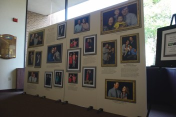 "The Loretto-Hilton staff put up a wall featuring interracial couples in the Webster Groves community as part of a lobby decoration for their current production, ""Guess Who's Coming to Dinner."" / photo by Hayden Andrews"
