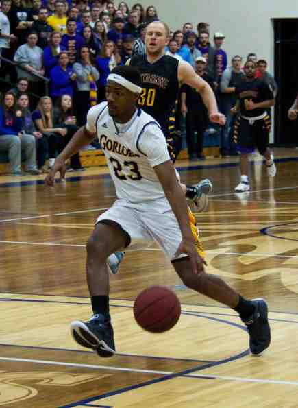 VICTORIA CASWELL/ The Journal Ahmad Smith drives to the rim in Webster's SLIAC tournament loss to Fontbonne University at Grant Gymnasium.
