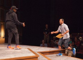 Filmmaker Tré Williams goes on stage to hand his short film to Lee. BRIAN VERBARG/The Journal
