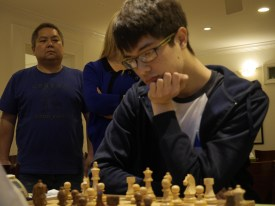 Coaches Paul Truong and Susan Polgar watch Ray Robson in round 2