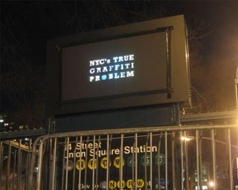 guerrilla art subvertising light criticism