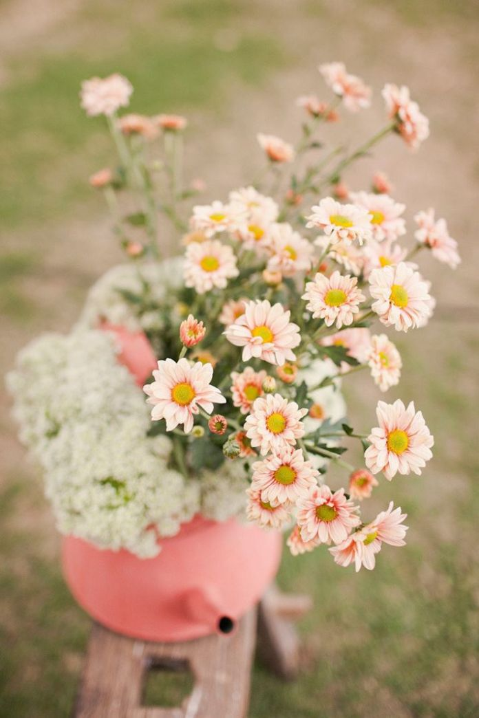 pastel peach and yellow daisy wedding flowers