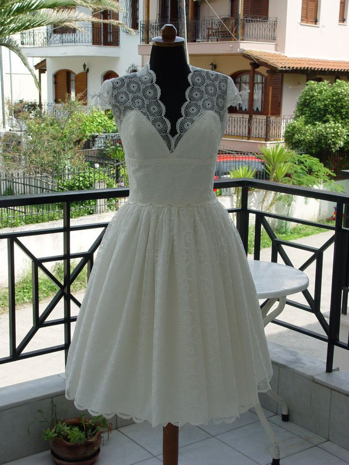 lovely lace LWDs for the brides wedding reception look cap sleeves with bows