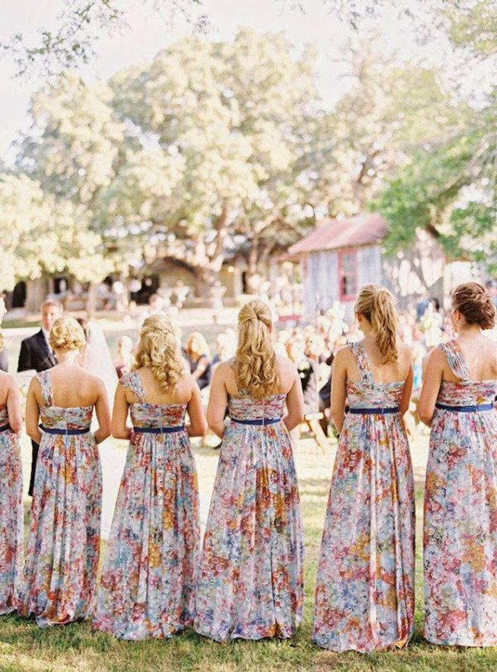 Bold floor length floral bridesmaids dresses