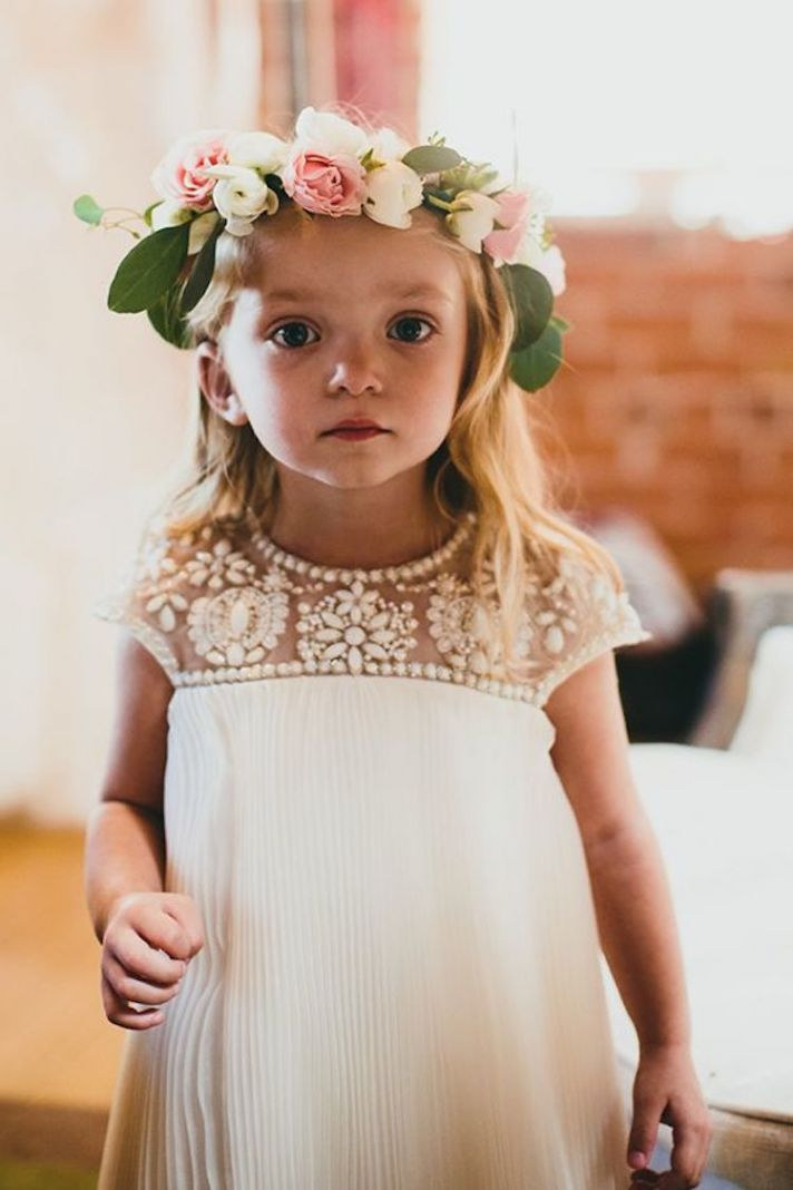 Adorable Flower Girl with Flower Crown and an Embellished Dress
