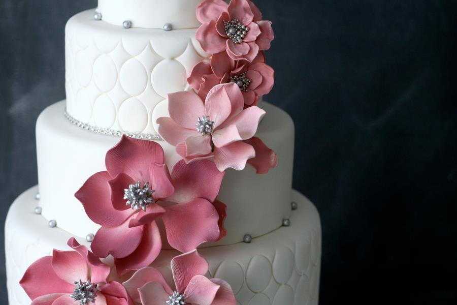 Elegant White Wedding Cake with Light Pink Blooms Silver Beads