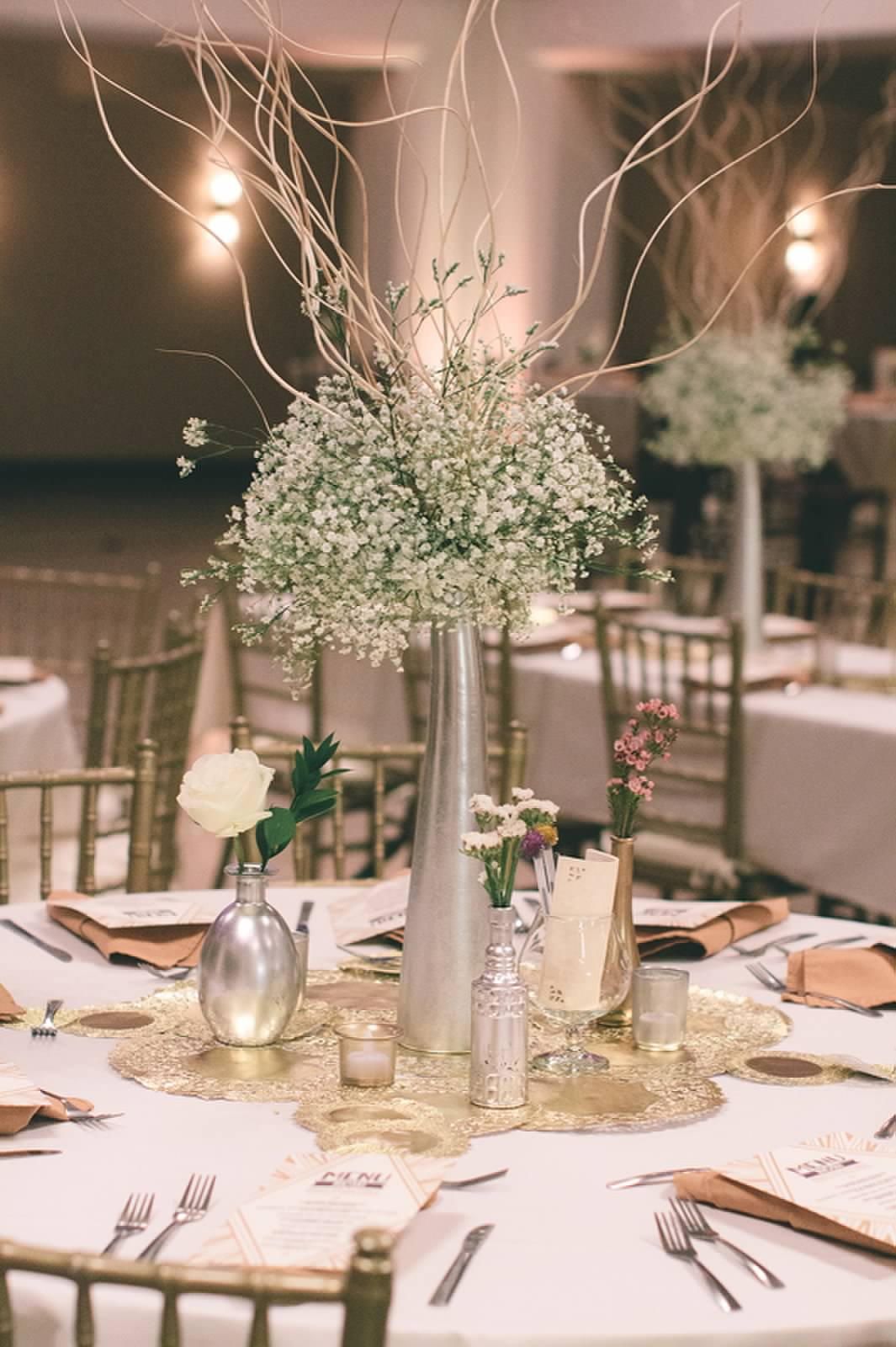 Tall centerpiece @ round table | OneWed.com