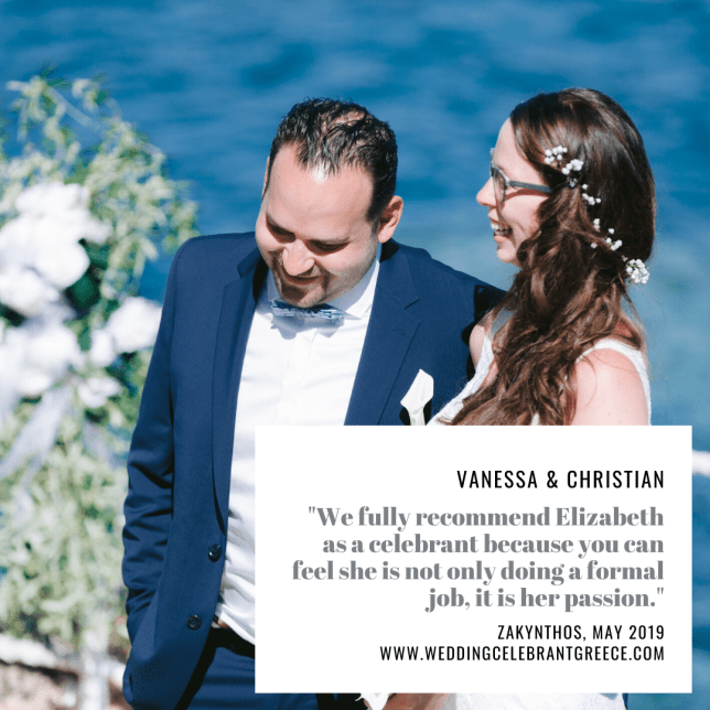 A happy couple during their wedding ceremony in Greece with wedding Celebrant ECK - a wedding Celebrant in Greece. In the background is a lovely wedding flower arrangement and the blue sea.
