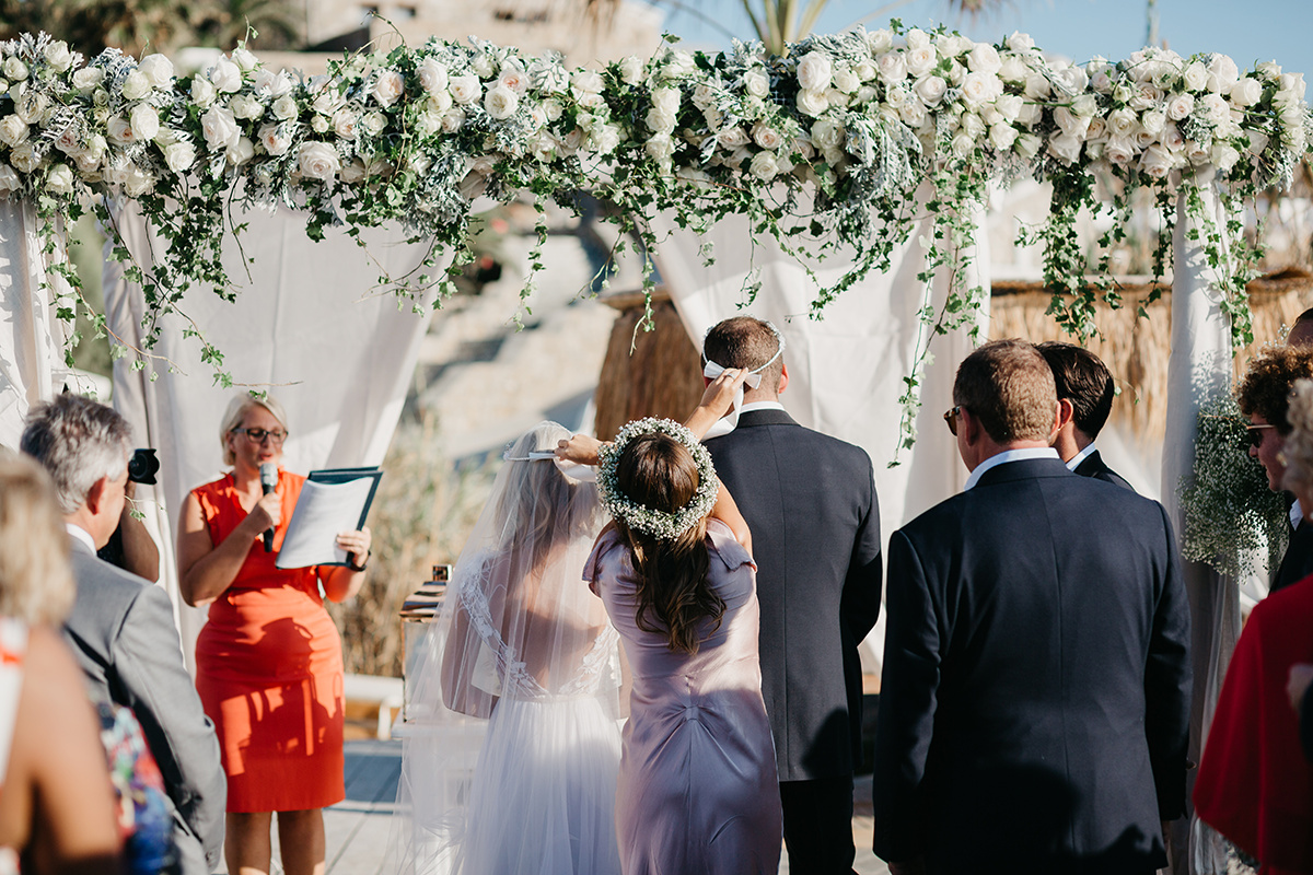 The Greek Wedding crown exchange during a wedding ceremony on the greek island of Mykonos. The ceremony was created by ECK - A wedding celebrant in Greece