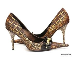 Pair of shiny female shoes isolated  on white