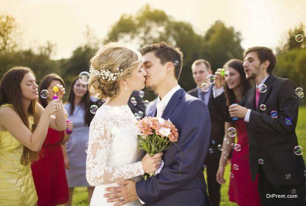 Newlyweds kissing at wedding reception