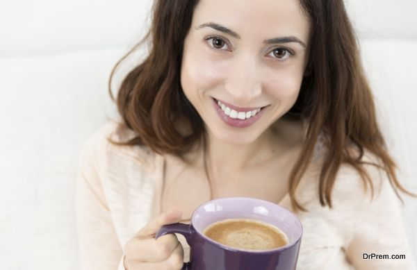 Attractive woman enjoying her cup of coffee