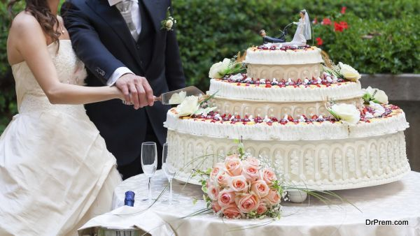 spouses cut their wedding cake