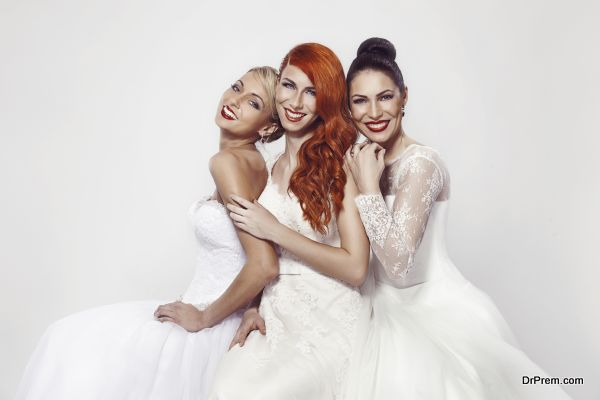 portrait of a three beautiful woman in wedding dress