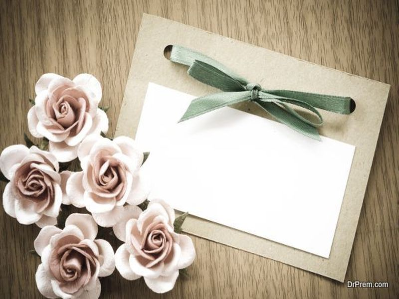 Vintage greeting card and rose flower.
