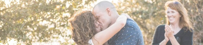 outer banks bride and groom kiss