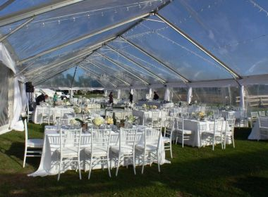 Clear top tent, string lights, crystal chandelier, white chiavari